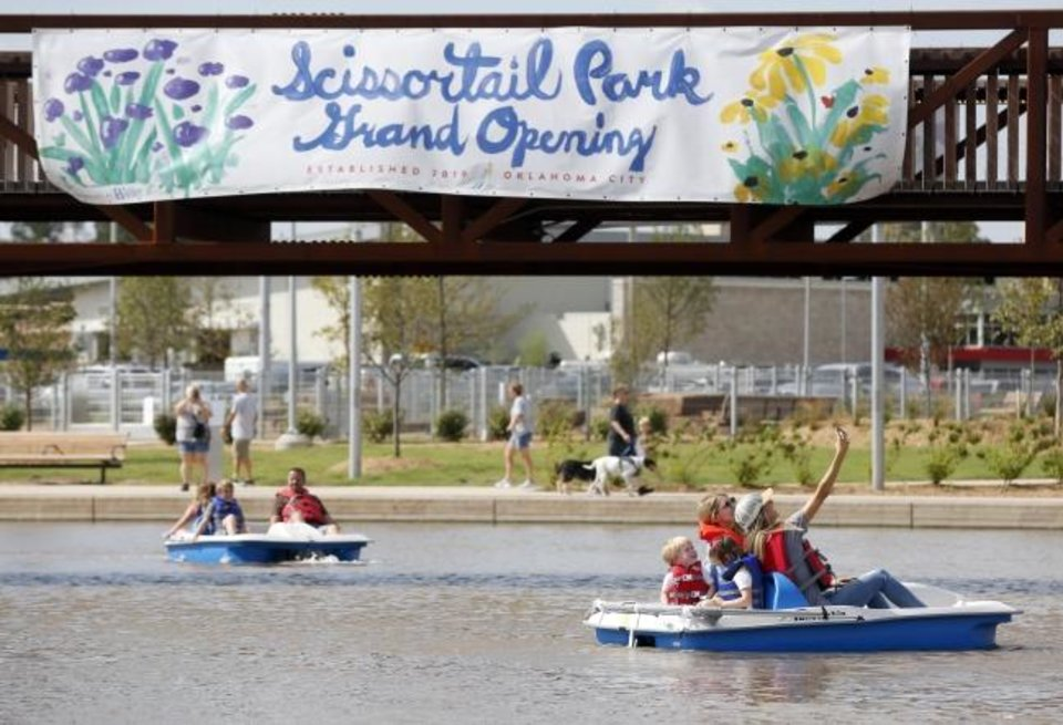 Photo -  People in a paddleboat take a selfie while on the lake Saturday during the grand opening weekend of Scissortail Park. [Nate Billings/The Oklahoman]