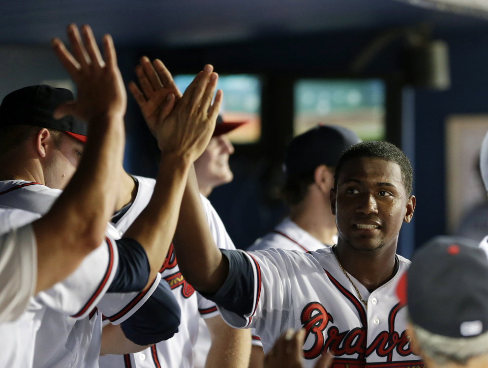 Photo - Atlanta Braves starting pitcher Julio Teheran (49) is greeted in the dugout by his teammates after being relieved in the ninth inning of a baseball game against the Minnesota Twins Monday, May 20, 2013, in Atlanta. (AP Photo/John Bazemore)