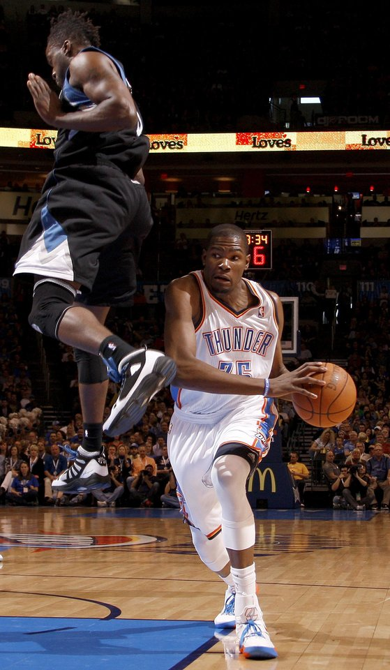 Photo - Oklahoma City's Kevin Durant (35) tries to get past Minnesota's Martell Webster (5) during the NBA basketball game between the Oklahoma City Thunder and the Minnesota Timberwolves at Chesapeake Energy Arena in Oklahoma City, Friday, March 23, 2012. Photo by Bryan Terry, The Oklahoman