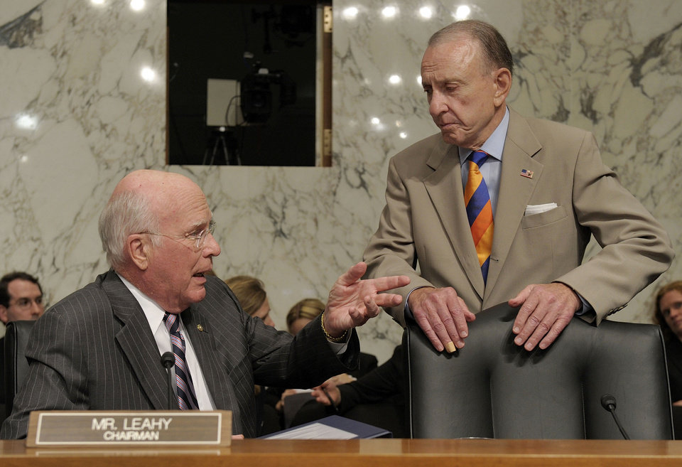 FILE - In a June 29, 2010 file photo, Senate Judiciary Committee Chairman Sen. Patrick Leahy, D-Vt., left, talks with committee member Sen. Arlen Specter, D-Pa., on Capitol Hill in Washington, during a break in Supreme Court nominee Elena Kagan\'s confirmation hearing before the committee. Former U.S. Sen. Arlen Specter, longtime Senate moderate and architect of one-bullet theory in JFK death, died Sunday, Oct. 14, 2012. He was 82. (AP Photo/Susan Walsh, File)