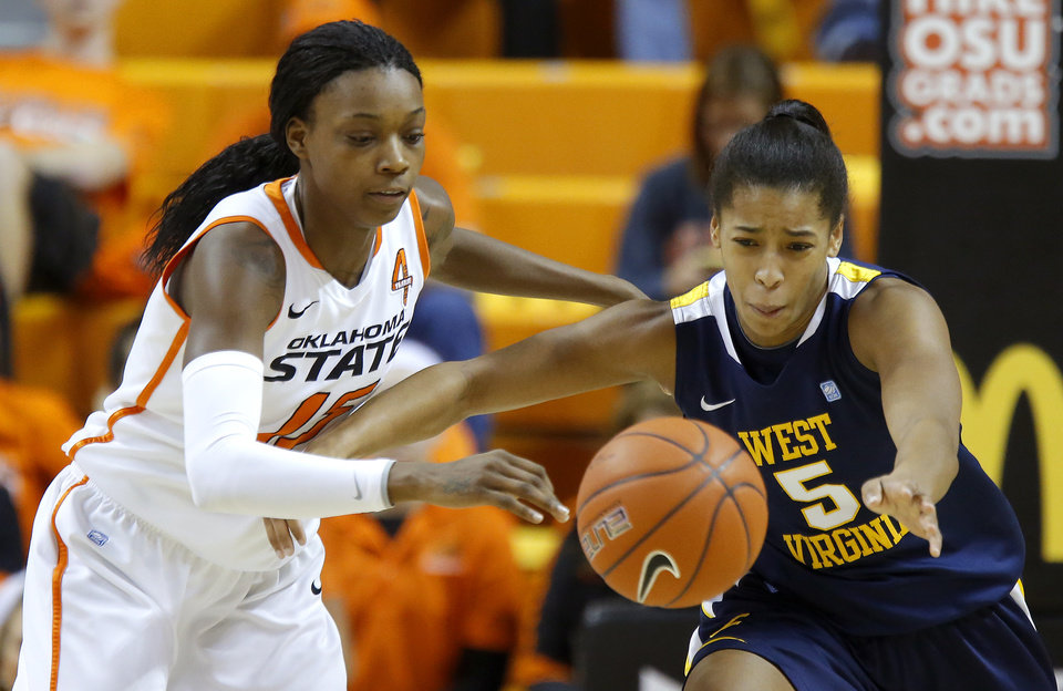 Oklahoma State's Toni Young (15) and West Virginia's Averee Fields (5) go for the ball during a women's college basketball game between Oklahoma State and West Virginia at Gallagher-Iba Arena in Stillwater, Okla.,  Tuesday, Jan. 29, 2013. Photo by Bryan Terry, The Oklahoman