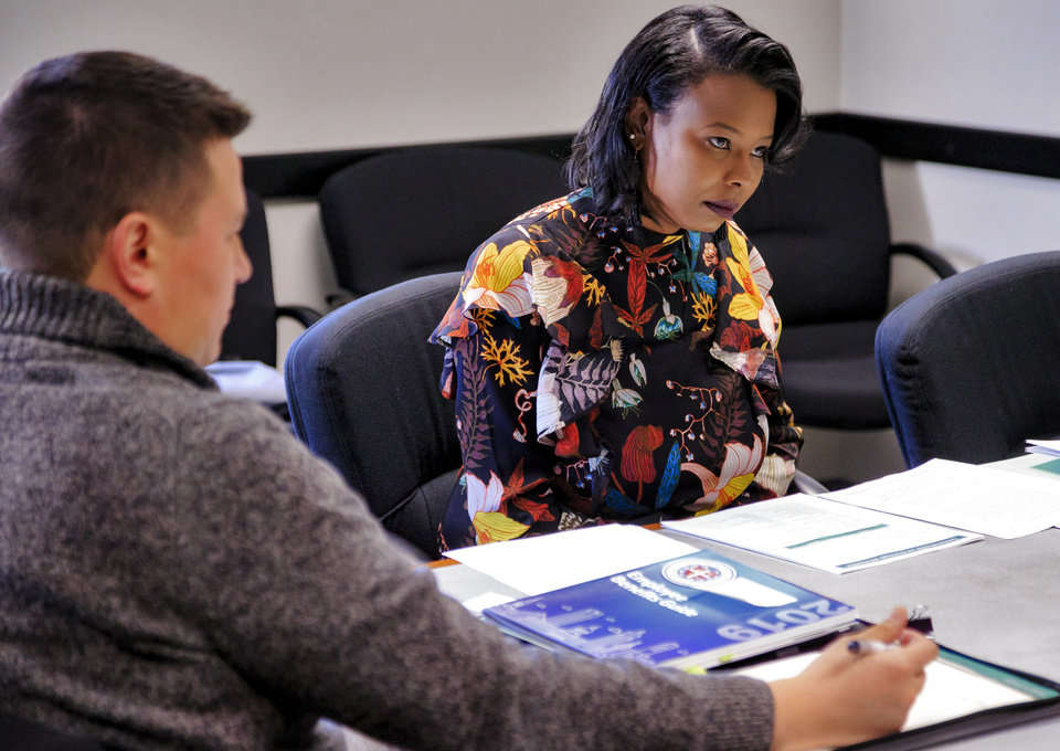 Photo - Ward 7 Councilwoman-elect Nikki Nice went over paperwork at City Hall as part of her orientation after winning election Nov. 6. She will be sworn in Monday in a special meeting called to interview city manager candidates. [Photo by Chris Landsberger, The Oklahoman]