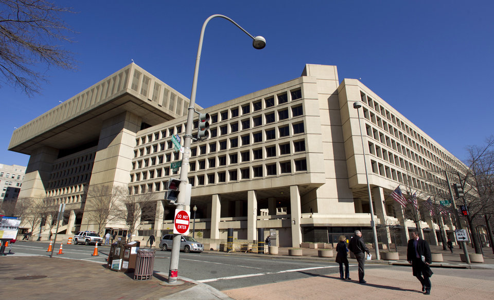 "FILE - This Feb. 3, 2012 file photo shows Federal Bureau of Investigation (FBI) headquarters in Washington. Just six blocks from the White House, the FBI's hulking headquarters overlooking Pennsylvania Avenue has long been the government building everyone loves to hate. The verdict: it's an ugly, crumbling concrete behemoth. An architectural mishap, all 2.4 million square feet of it. But in this time of tight budgets, massive deficits and the ""fiscal cliff,"" the 38-year-old FBI headquarters building has one big thing in its favor. It sits atop very valuable real estate, an entire city block on American's Main Street midway between the U.S. Capitol and the White House. Just how valuable, the General Services Administration intends to find out. (AP Photo/Manuel Balce Ceneta, File)"