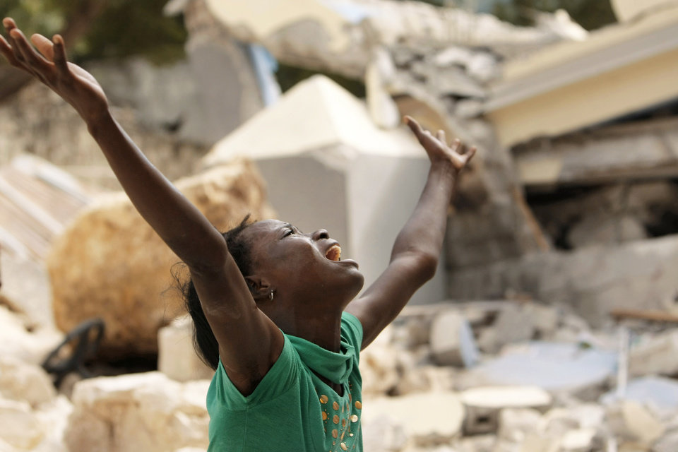Photo - Cindy Terasme screams Thursday after seeing the feet of her dead 14-year-old brother, Jean Gaelle Dersmorne, in the rubble of the collapsed St. Gerard School in Port-au-Prince, Haiti. AP PHOTO