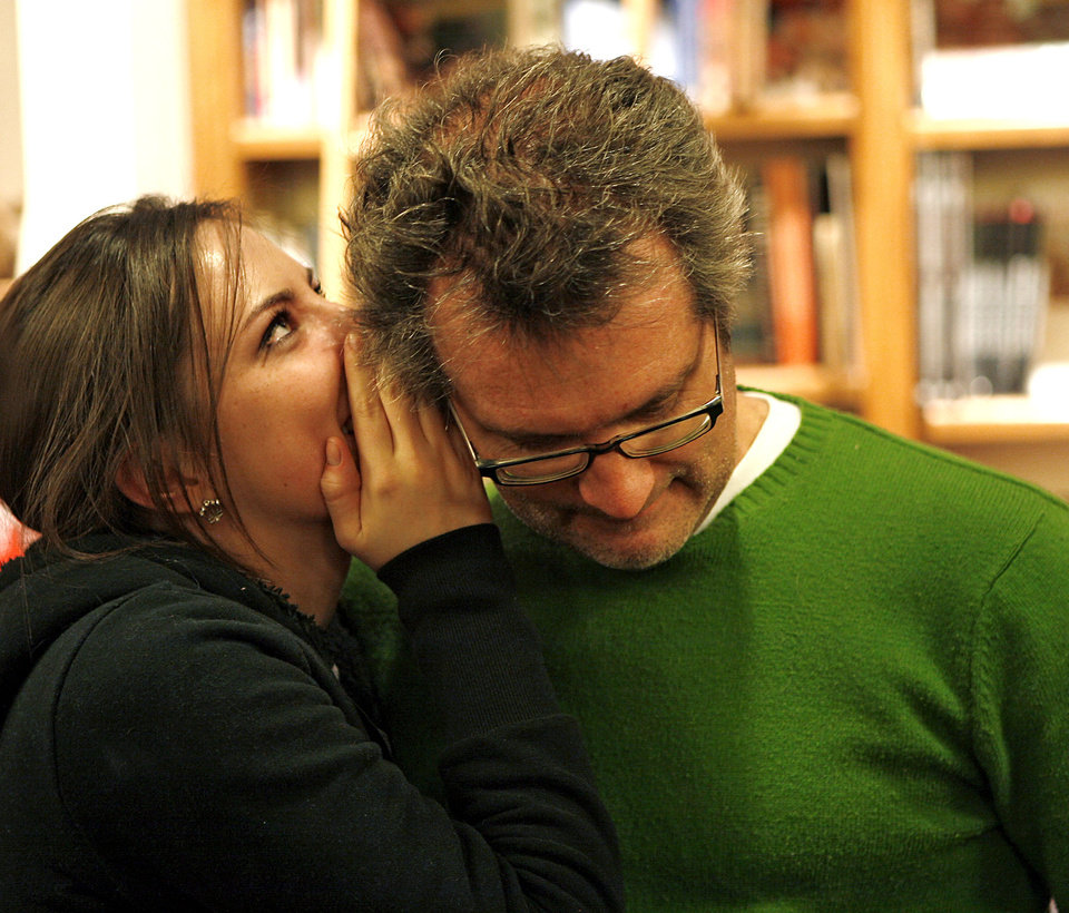 Photo - CANCER PATIENT: Maddye Chastain talks with her father, Jim Chastain, during Jim's birthday party at Full Circle Bookstore in Oklahoma City on Dec. 10, 2008. By John Clanton, The Oklahoman  ORG XMIT: KOD