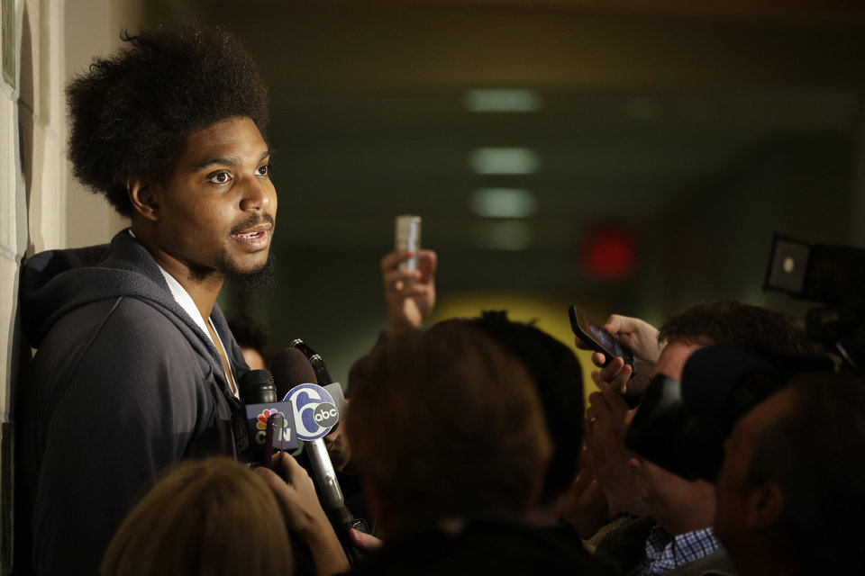 Photo - Philadelphia 76ers' Andrew Bynum speaks to members of the media at the team's NBA training facility Friday, March 1, 2013, in Philadelphia. (AP Photo/Matt Rourke)