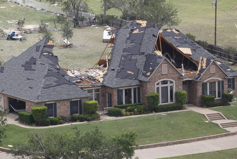 Photo - A home in Cleburne, Texas has portions of its roof missing on Thursday May 16, 2013. Ten tornadoes touched down in several small communities in North Texas overnight, leaving at least six people dead, dozens injured and hundreds homeless.  (AP Photo/Star-Telegram,Ron T. Ennis)  MAGS OUT; (FORT WORTH WEEKLY, 360 WEST)
