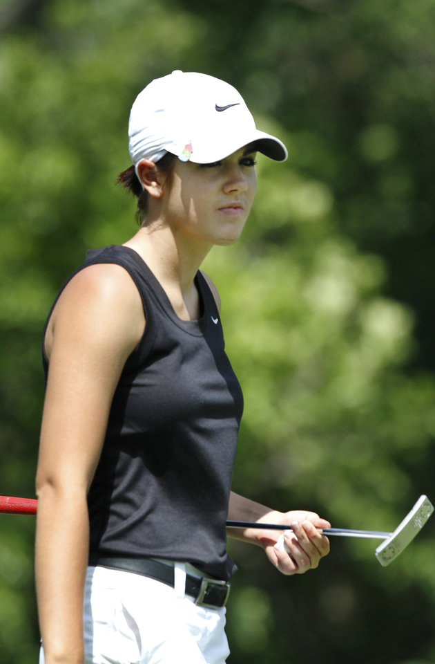 Photo - Maci Arrington of Hinton High School, walks off #9 green after sinking a  putt during Girl's Class 2A State Golf Tournament at Trosper Park Golf Course on Wednesday, May 2,  2012.    Photo by Jim Beckel, The Oklahoman
