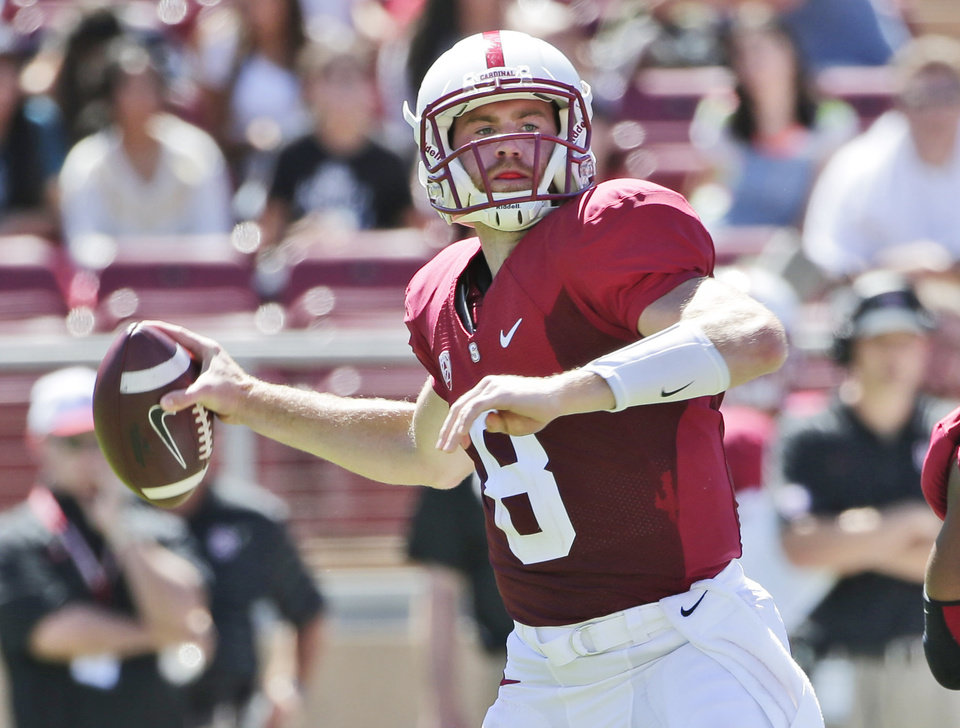 Photo - Stanford quarterback Kevin Hogan throws against UC Davis during the first half of an NCAA college football game on Saturday, Aug. 30, 2014, in Stanford, Calif. (AP Photo/Marcio Jose Sanchez)