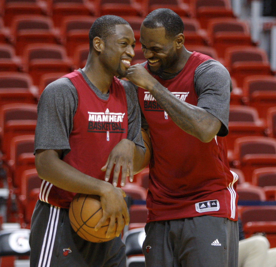 Miami\'s Dwyane Wade, left, and LeBron James laugh during a practice before Game 4 of the NBA Finals between the Oklahoma City Thunder and the Miami Heat at American Airlines Arena, Monday, June 18, 2012. Photo by Bryan Terry, The Oklahoman
