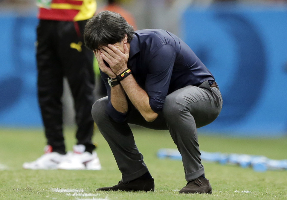 Photo - Germany's head coach Joachim Loew reacts during the group G World Cup soccer match between Germany and Ghana at the Arena Castelao in Fortaleza, Brazil, Saturday, June 21, 2014. (AP Photo/Matthias Schrader)
