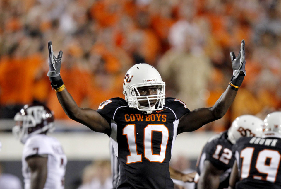 Photo - OSU's Markelle Martin celebrates a defensive stop during the college football game between Texas A&M University (TAMU) and Oklahoma State University (OSU) at Boone Pickens Stadium in Stillwater, Okla., Thursday, Sept. 30, 2010. Photo by Sarah Phipps, The Oklahoman