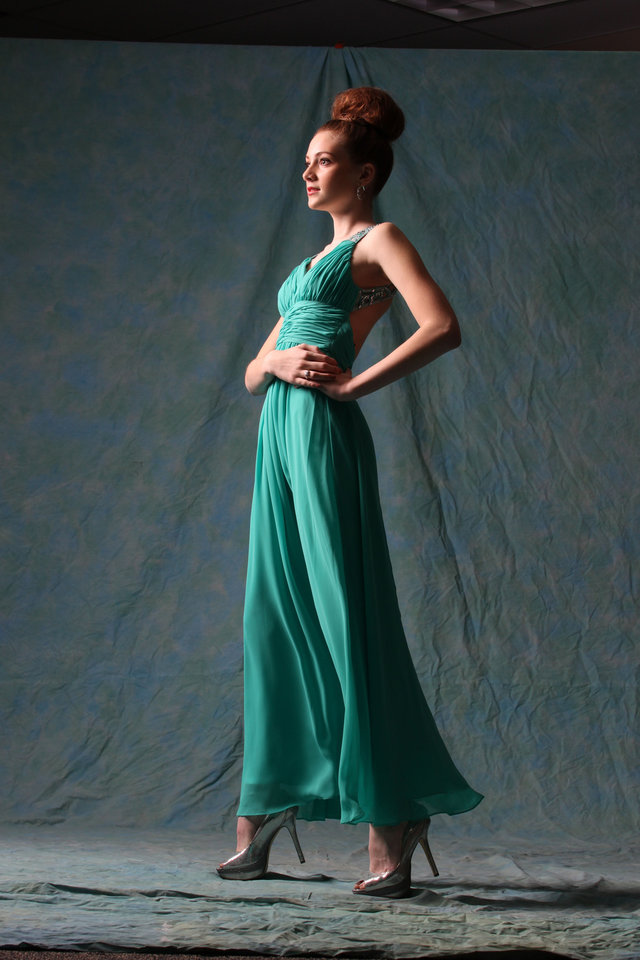 Model Addison wears a jade chiffon full-length gown with empire waist and jewel-encrusted detailing by B. Darlin, $189.  Silver metallic peep-toe pumps by Gianni Bini, $89. Both sold at Dillard's Penn Square Mall. Photo by Steve Webb, for the Oklahoman.   <strong></strong>
