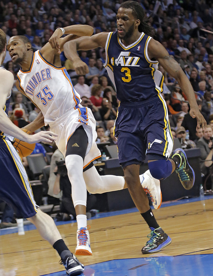 Utah Jazz's DeMarre Carroll (3) fouls Oklahoma City Thunder's Kevin Durant (35) during the NBA basketball game between the Oklahoma City Thunder and the Utah Jazz at Chesapeake Energy Arena on Wednesday, March 13, 2013, in Oklahoma City, Okla. Photo by Chris Landsberger, The Oklahoman