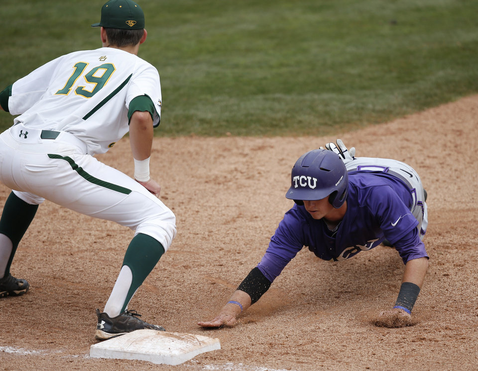 Photo - TCU's Keaton Jones, right, gets back to first base safely as Baylor first baseman Aaron Dodson (19) waits for the throw in the eighth inning of a game in the Big 12 Conference NCAA college baseball tournament in Oklahoma City, Saturday, May 24, 2014. TCU won 4-1 and advances to the championship game on Sunday. (AP Photo/Sue Ogrocki)