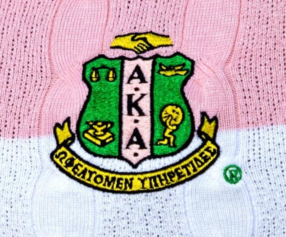 Photo -  Christina Kirk's sweater features the  Alpha Kappa Alpha (AKA) Black Greek sorority crest. Chris Landsberger/The Oklahoman]