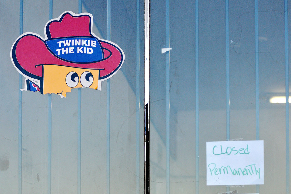 "The head of Twinkie The Kid poster remains on the Wonder Hostess Bakery Outlet store in Victorville, Calif, where a posted sign displays ""closed permanently,"" at the empty commercial property on Tuesday, Nov. 20, 2012. The store's last day open to the public was on Saturday, Nov. 17, 2012. (AP Photo/The Victor Valley Daily Press, David Pardo)"