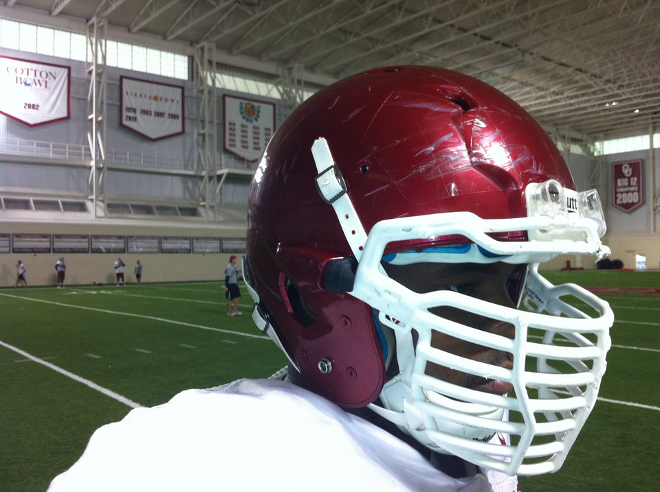 Photo - Oklahoma's Jamarkus McFarland shows off his facemask. Photo by OU Athletics Communications