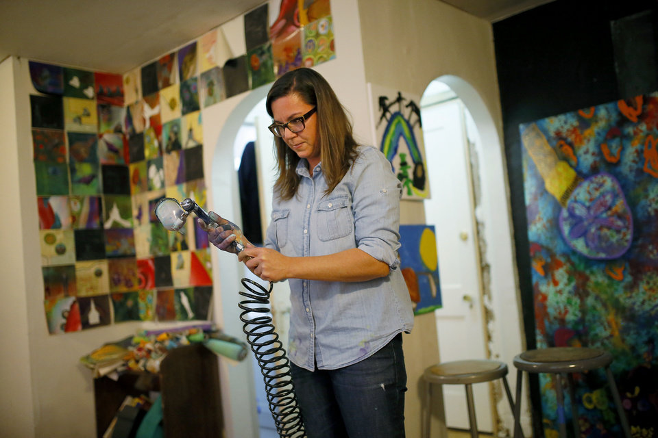 Erin Shaw works on a painting inside her Oklahoma City studio for an upcoming show, Wednesday, Dec., 4, 2013. Erin and her husband Jim Shaw returned to Oklahoma City after moving away years ago. Photo by Bryan Terry, The Oklahoman