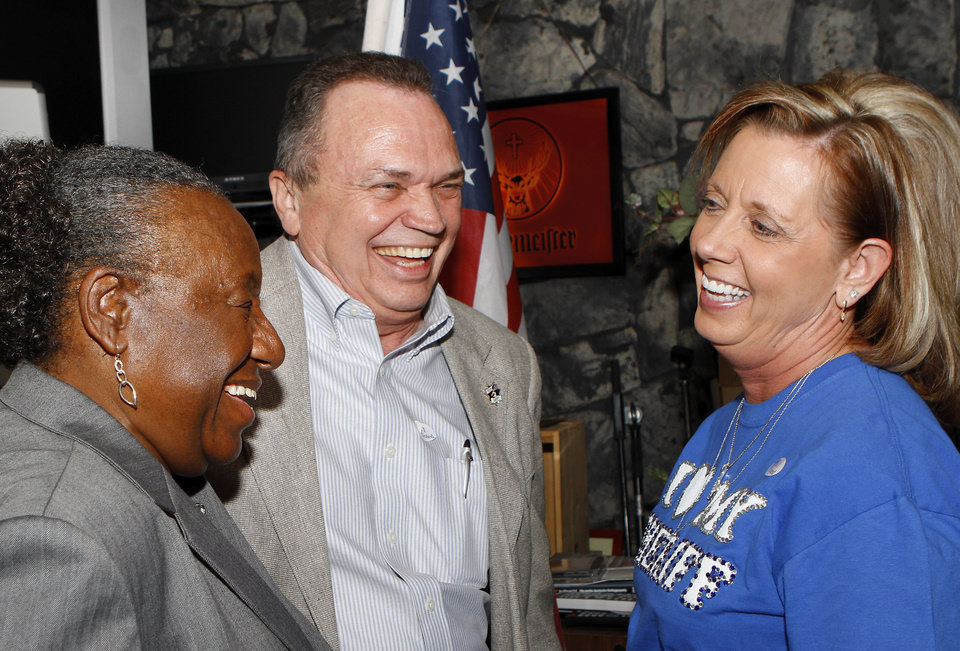 Sheriff Whetsel laughs with his wife, Mitzi, right, and Oklahoma County Commissioner Willa Johnson.  About 200  friends and supporters  of Oklahoma County Sheriff John Whetsel gathered in Choctaw at Old Germany Restaurant to watch election results and cheer the numbers as they were shown on large television screens throughout the building Tuesday night, Nov. 6, 2012.   Photo by Jim Beckel, The Oklahoman