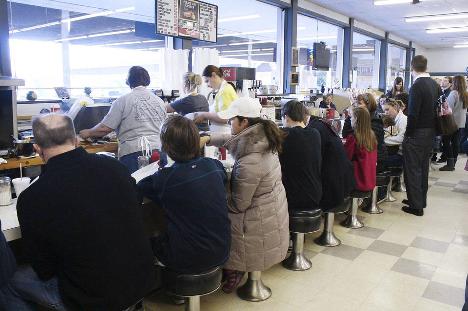 Photo - Customers filled the counter on Jan. 20, 2012, which was the last day Nichols Hills Drugstore was open at its original site. The Oklahoman Archives