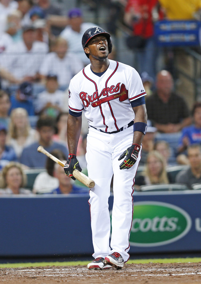 Photo - Atlanta Braves left fielder Justin Upton (8) reacts after striking out in the third inning of a baseball game against the New York Mets in Atlanta, Monday, June 30, 2014. (AP Photo/John Bazemore)