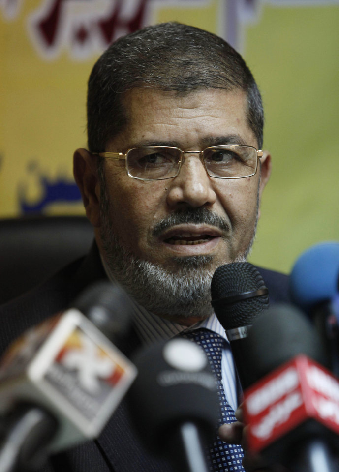 FILE - In this Monday, Nov. 22, 2010 file photo, Muslim Brotherhood spokesman Mohammed Morsi speaks during a press conference alleging early fraud in Egypt parliamentary elections, at the group's offices in Cairo, Egypt. A panel of fundamentalist Islamic clerics has endorsed the candidate of the Muslim Brotherhood for president of Egypt, an attempt to prevent a split of the conservative Muslim voters. The ultraconservative endorsement boosted the Brotherhood candidate, Mohammed Morsi, who faces competition in next month's election from a more moderate Islamist, Abdel-Moneim Abolfotoh, who broke ranks with the group. (AP Photo/Nasser Nasser)