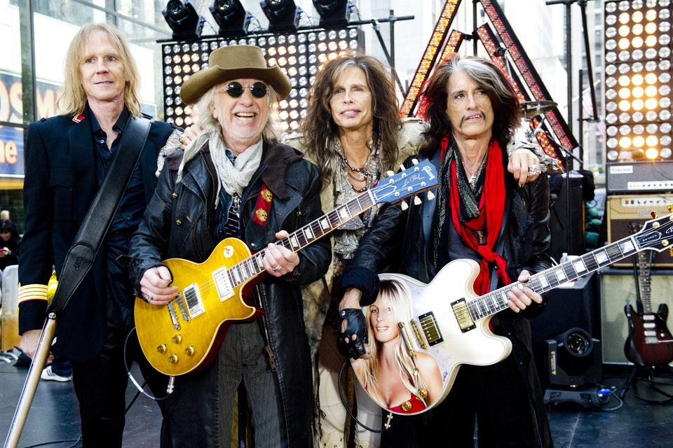 Photo - FILE - This Nov. 2, 2012 file photo shows, from left, Tom Hamilton, Brad Whitford, Steven Tyler and Joe Perry of Aerosmith perform on NBC's