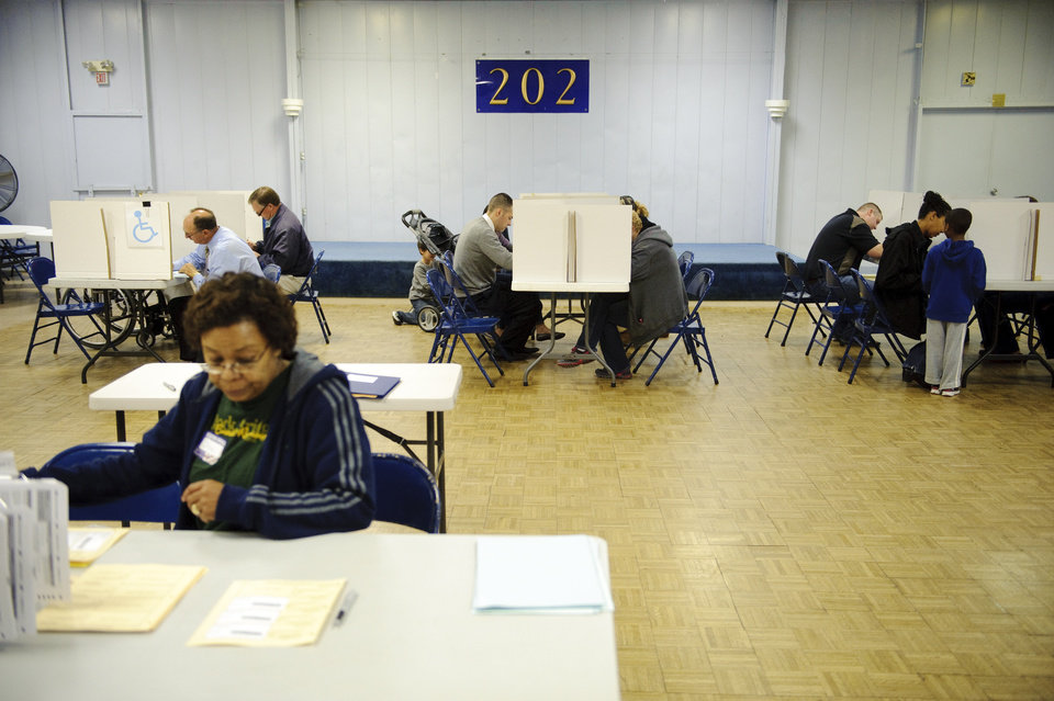 Photo -   Voters work on their ballots at the American Legion Post #202 in Columbia, Mo., on Tuesday, Nov. 6, 2012. (AP Photo/Columbia Daily Tribune, Ryan Henriksen)