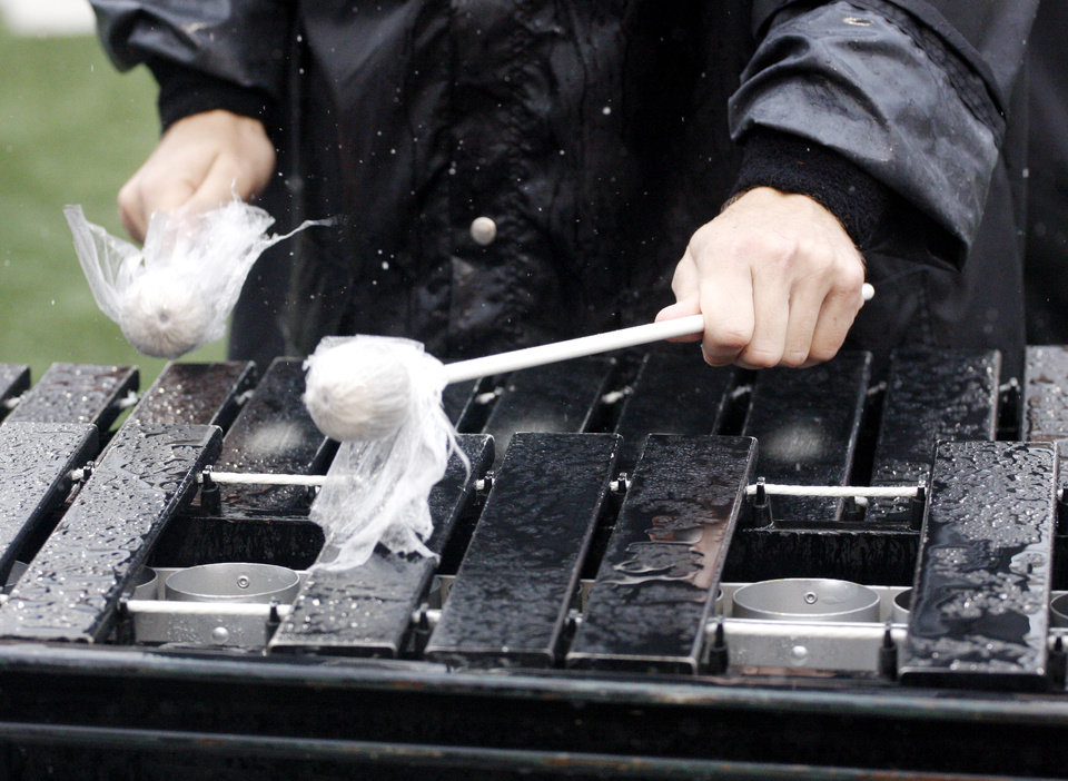 Photo - Rains leaves standing water on a xylophone during pregame band performance at the Oklahoma State University (OSU) football game against Missouri State University (MSU) Saturday Sept. 13, 2008 at Boone Pickens Stadium in Stillwater, Okla. BY DOUG HOKE, THE OKLAHOMAN.