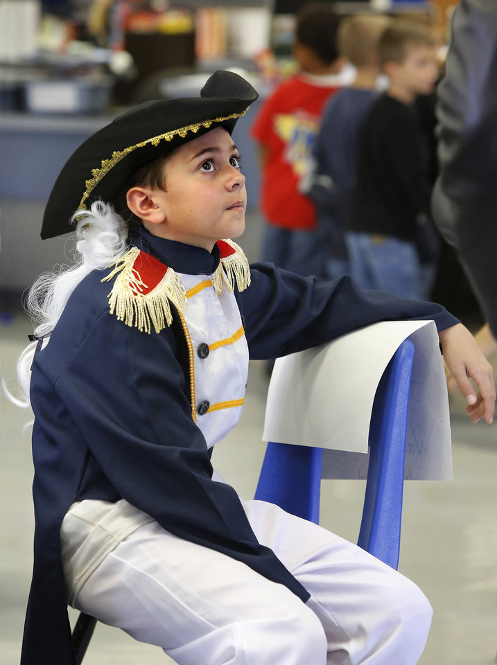 Photo - Lane Youngblood is dressed as General George Washington. Wearing authentic era attire, students in Rhonda Watkins' fourth and fifth grade social studies classes at Schwartz Elementary School portrayed various figures from the American Revolution period during  a living history museum program in the school's library on Wednesday,  Jan. 30,  2013.  The students selected a historical person from a list provided by Watkins, and  were required to research the subject, write a report and make a verbal presentation about the person. All students in the school were invited to the library to hear the characters tell about their lives.   Photo by Jim Beckel, The Oklahoman