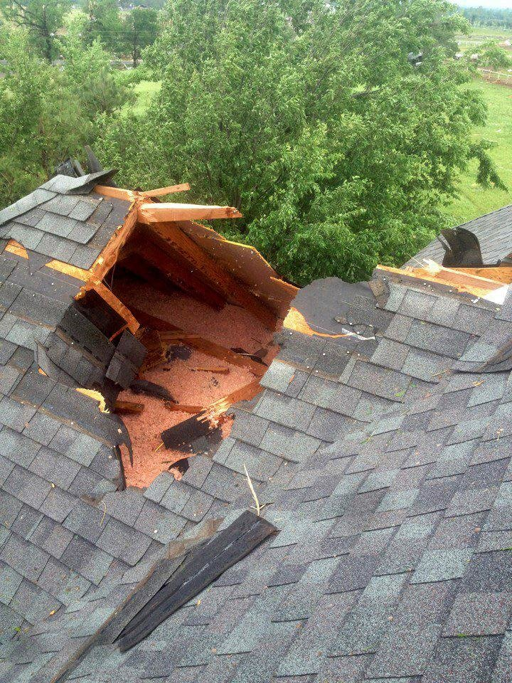 Photo - Debris knocked a hole in the roof of Joshua Stacey's home at 2533 SW 149 in south Oklahoma City.  PROVIDED - Photo provided
