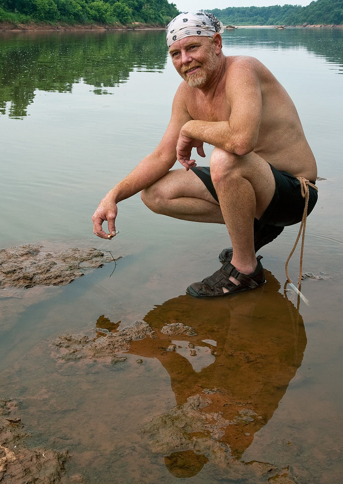 Lee McFarlin takes a break after trying to noodle a catfish. Lee McFarlin tries to catch catfish with his bare hands in the Cimarron River outside of Ripley, Okla., on Friday July 2, 2010. Photo by Mitchell Alcala, The Oklahoman
