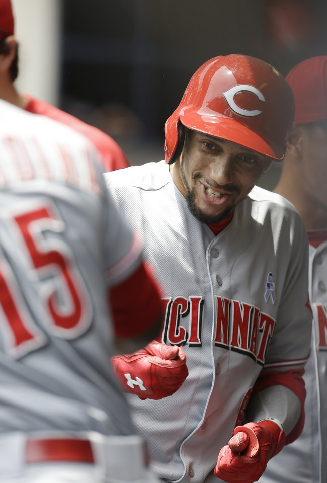 Photo - Cincinnati Reds' Billy Hamilton reacts in the dugout after his home run against the Milwaukee Brewers during the first inning of a baseball game on Sunday, June 15, 2014, in Milwaukee. (AP Photo/Jeffrey Phelps)