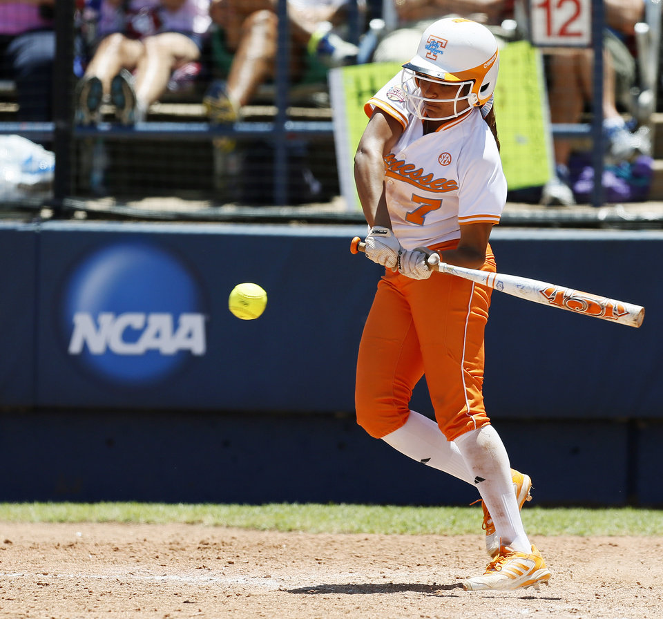 Tennessee's Tory Lewis (7) drives in the game-winning run in the bottom of the seventh inning during an NCAA softball game in the Women's College World Series between Washington and Tennessee at ASA Hall of Fame Stadium in Oklahoma City, Saturday, June 1, 2013. Tennessee won 1-0. Photo by Nate Billings, The Oklahoman