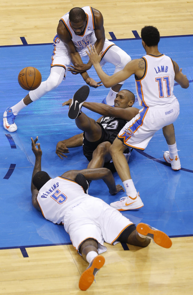 Photo - Oklahoma City's Kevin Durant (35), Jeremy Lamb (11) and Oklahoma City's Kendrick Perkins (5) fight Boris Diaw (33) for a loose ball during Game 2 of the Western Conference semifinals in the NBA playoffs between the Oklahoma City Thunder and the Los Angeles Clippers at Chesapeake Energy Arena in Oklahoma City, Monday, May 7, 2014. Photo by Bryan Terry, The Oklahoman