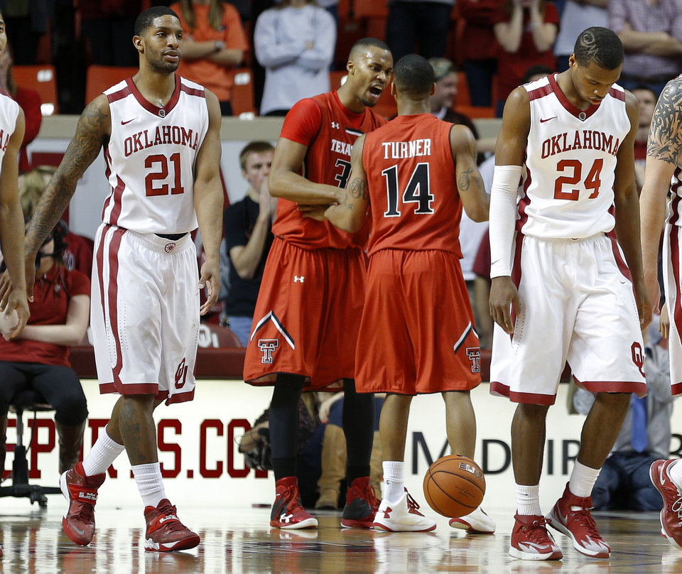 Photo - Oklahoma's Cameron Clark (21) and Buddy Hield (24) walk towards the bench as Texas Tech's Jaye Crockett (30) and Robert Turner (14) celebrate after an Oklahoma foul during an NCAA college basketball game between the University of Oklahoma and Texas Tech University at the Lloyd Noble Center in Norman, Okla., Wednesday, Feb. 12, 2014. Oklahoma lost 68-60. Photo by Bryan Terry, The Oklahoman