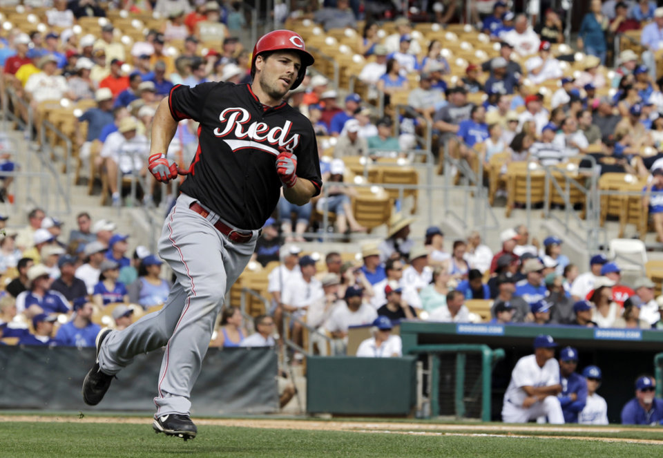 Photo - Cincinnati Reds' Chris Heisey makes the turn at first base on his three-run home run off Los Angeles Dodgers starting pitcher Paul Maholm in the third inning of a spring exhibition baseball game Thursday, March 13, 2014, in Glendale, Ariz. (AP Photo/Mark Duncan)