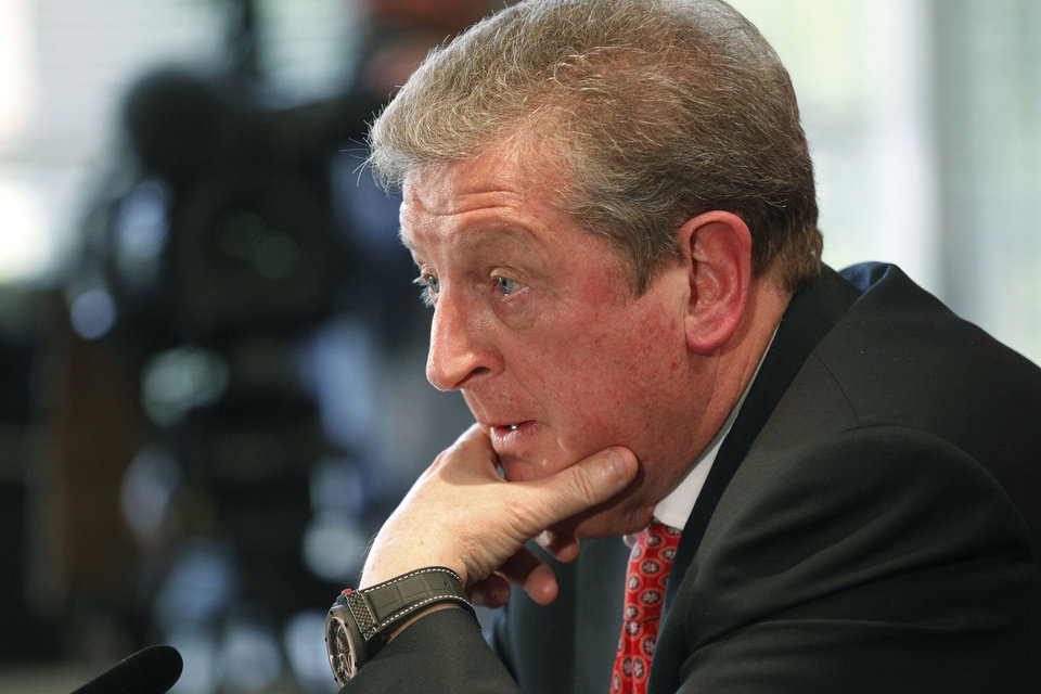 Photo - England's soccer manager Roy Hodgson,  announces the squad for the World Cup in Brazil at Vauxhall headquarters,  in Luton, England, Monday, May 12, 2014.  Hodgson selected a World Cup squad containing several young players on Monday, although Frank Lampard was among the veterans to still make the cut. (AP Photo/Sang Tan)