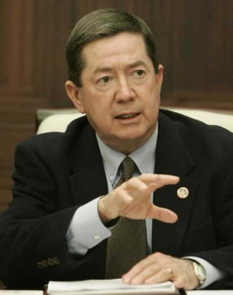 "Oklahoma state Attorney General  Drew  Edmondson gestures as he speaks Friday, Feb. 13, 2009, at a news conference, saying that it is ""highly likely"" that poultry litter spread across pastures in Mayes County was the source of E. coli bacteria that contaminated well water at a restaurant in Locust Grove last year, killing one person and sickening more than 300 others. (AP Photo/Sue Ogrocki)"