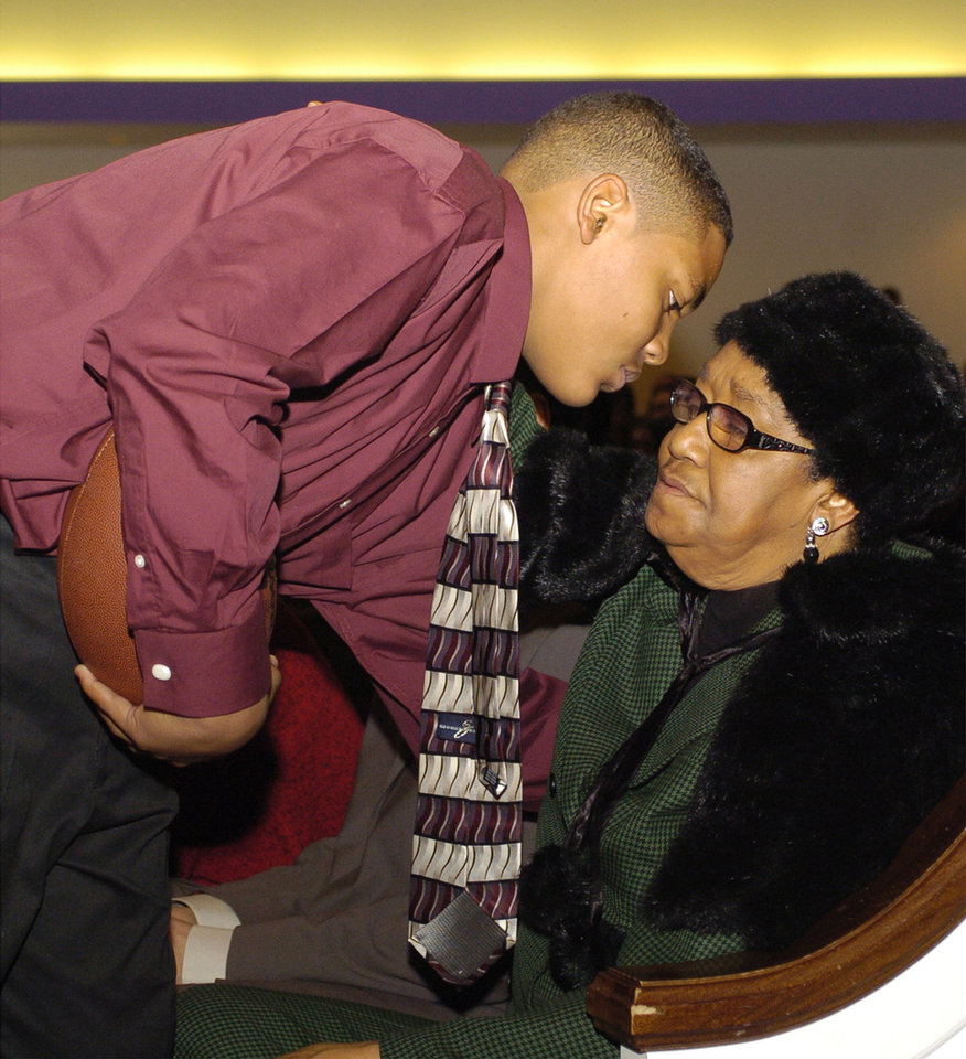 "Richard Allen ""Mandrell"" Dean's mother Loyce Dean, right, gets a hug from Mandrell's son Quintaz Struble during funeral services for his father (and her son) Saturday, February 3, 2007, at Fairview Baptist Church in Oklahoma City, OK. Dean, a former standout football recruit from Millwood, was killed during a home invasion. Photo by Kevin Ellis for The New York Times"