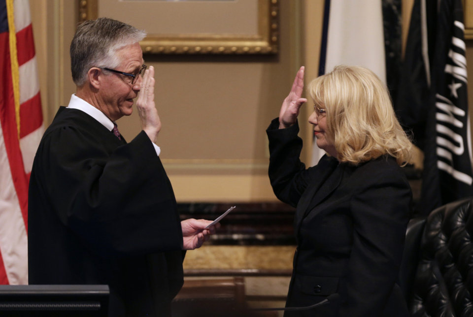 Photo - Sen. Pam Jochum, D-Dubuque, is sworn in as President of the Iowa Senate by Iowa Supreme Court Chief Justice Mark Cady, left, during the opening day of the Iowa Legislature, Monday, Jan. 14, 2013, at the Statehouse in Des Moines, Iowa. (AP Photo/Charlie Neibergall)