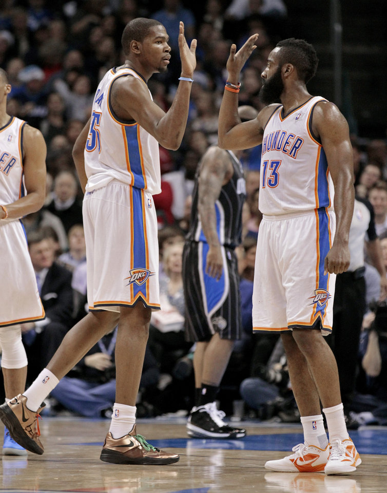 Oklahoma City Thunder's Kevin Durant and Oklahoma City Thunder's James Harden (13) congratulate each other in the first half as the Oklahoma City Thunder play the Orlando Magic in NBA basketball at the Chesapeake Energy Arena on Sunday, Dec. 25, 2011, in Oklahoma City, Okla.  Photo by Steve Sisney, The Oklahoman