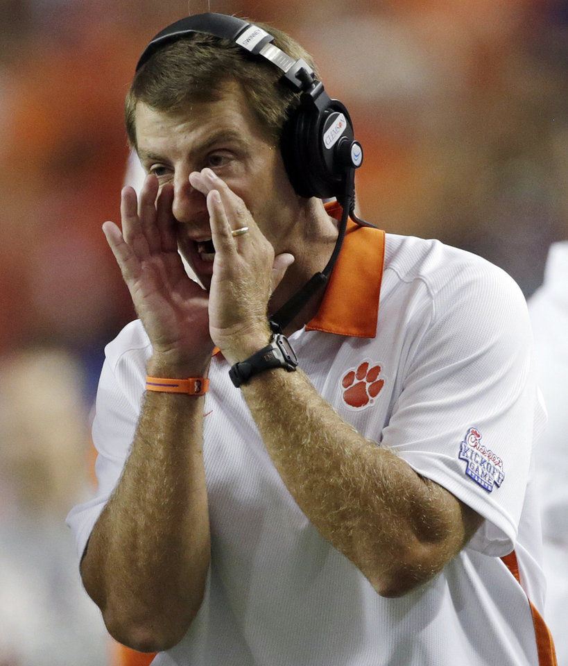 Photo -   Clemson Coach Dabo Swinney yells in instructions in the first quarter of a NCAA college football game against Auburn at the Georgia Dome in Atlanta Saturday, Sept. 1, 2012. (AP Photo/Dave Martin)