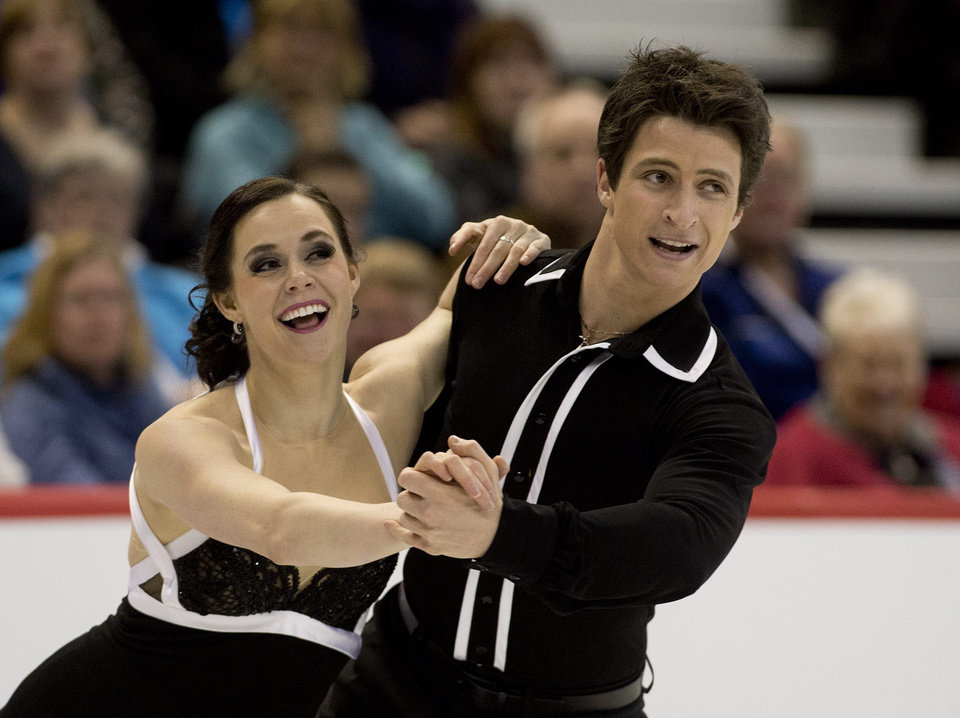Photo - Tessa Virtue and Scott Moir perform their short program during senior dance competition at the Canadian Figure Skating Championships in Ottawa, Ontario, on Friday, Jan. 10, 2014. (AP Photo/The Canadian Press, Adrian Wyld)