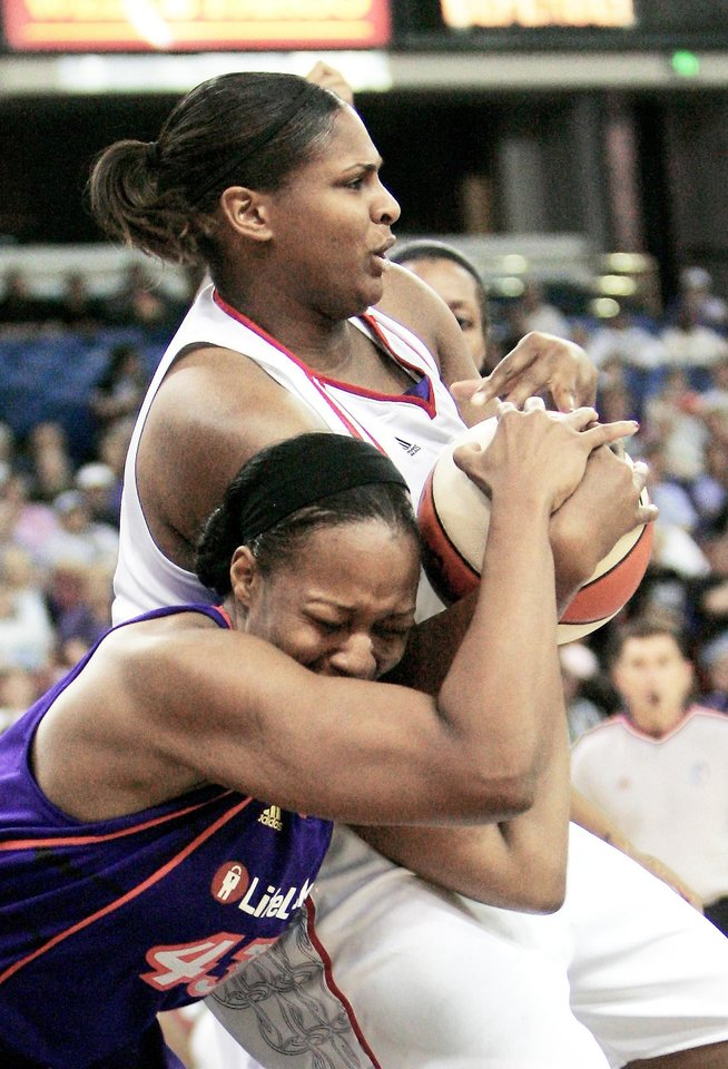 Photo - Courtney Paris is averaging 2.7 points and 2.7 rebounds per game in the WNBA this season. (AP Photo)
