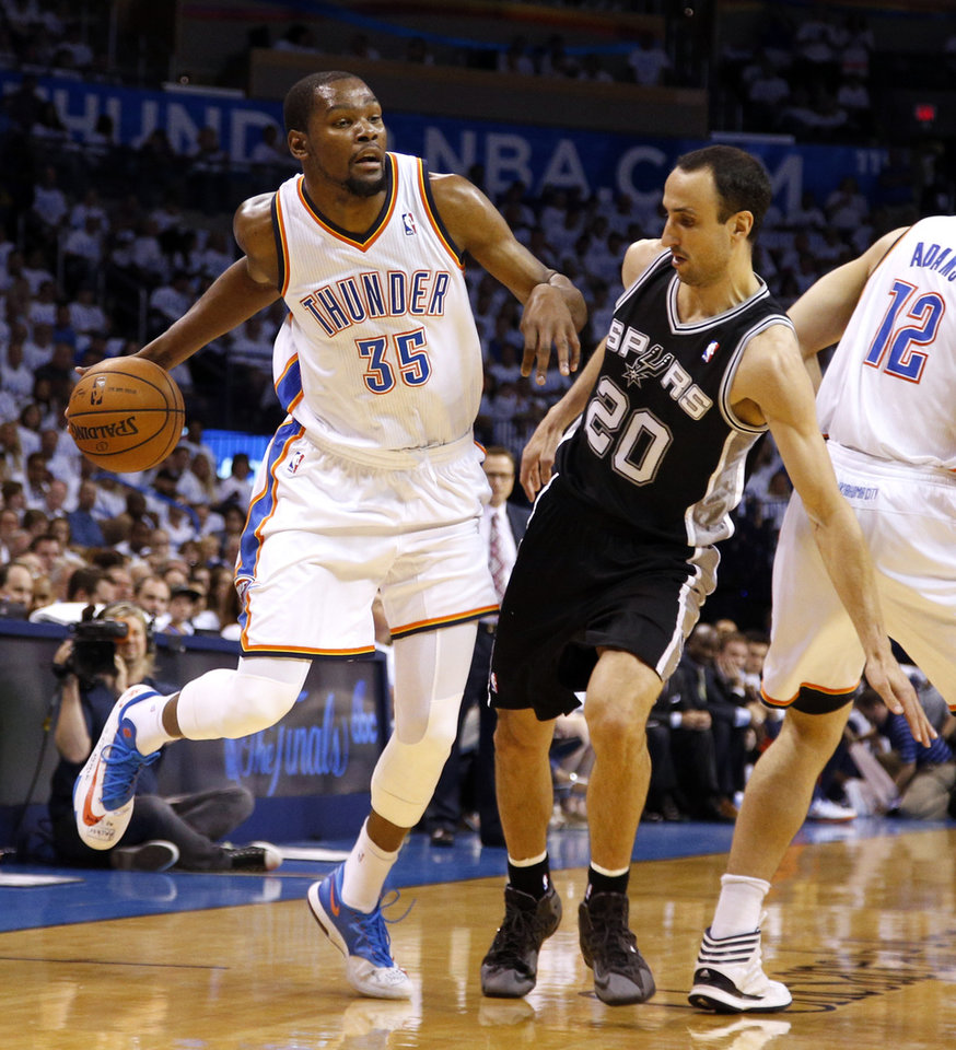Photo - Oklahoma City's Kevin Durant (35) looks to get by San Antonio's Manu Ginobili (20) during Game 6 of the Western Conference Finals in the NBA playoffs between the Oklahoma City Thunder and the San Antonio Spurs at Chesapeake Energy Arena in Oklahoma City, Saturday, May 31, 2014. Photo by Bryan Terry, The Oklahoman