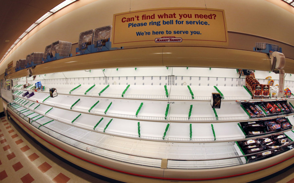 Photo - This photo made with a fisheye lens shows a sign atop mostly empty meat shelves at Market Basket in Haverhill, Mass., Monday, Aug. 18, 2014. As an employee revolt at the New England grocery store chain headed into its fifth week, the governors of Massachusetts and New Hampshire made the unusual move of personally stepping into negotiations aimed at ending a standoff threatening the future of the popular low-priced supermarkets. (AP Photo/Elise Amendola)