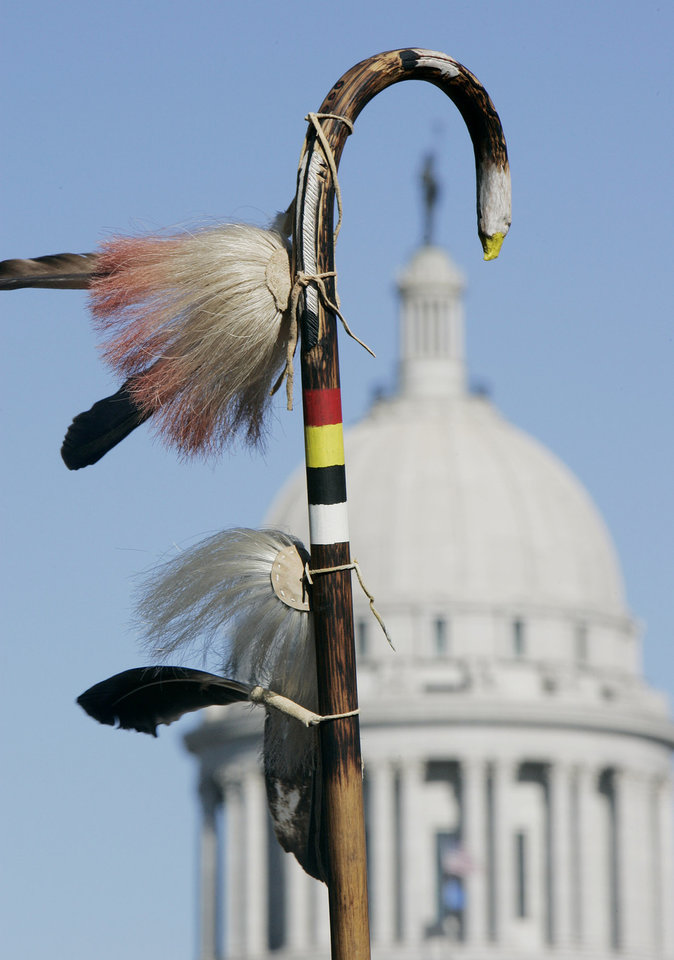 Photo - Rodney Factor of Seminole holds his eagle staff during the Oklahoma Indians Survival Walk and Remembrance Ceremony Firday, Nov. 16, 2007 near the state Capitol. BY JACONNA AGUIRRE/THE OKLAHOMAN.
