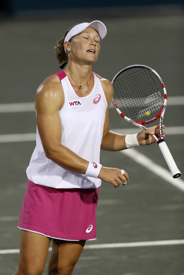 Photo - Samantha Stosur, of Australia, reacts following a point during a match against Lucie Safarova, of the Czech Republic, at the Family Circle Cup tennis tournament in Charleston, S.C., Thursday, April 3, 2014. (AP Photo/Mic Smith)